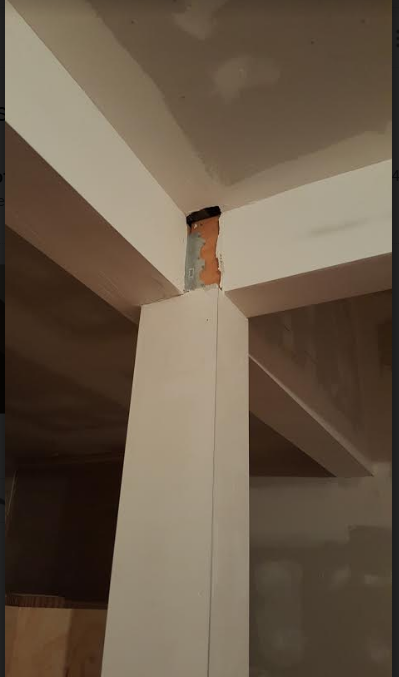 closeup of missing drywall