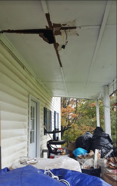 Damaged back porch ceiling