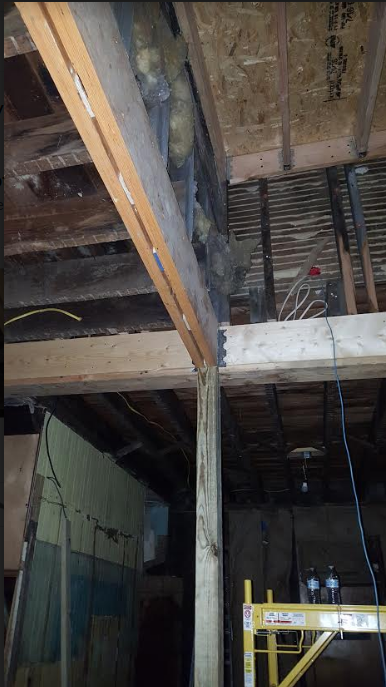 engineered beam supporting weight bearing true 2x4s