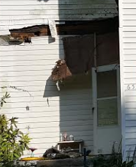 front porch with floor board breaking beam still hanging